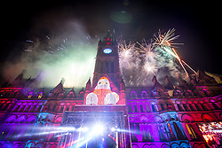 © Licensed to London News Pictures . 08/11/2013 . Manchester , UK . Fireworks over Manchester Town Hall . The stage in Albert Square in Manchester in front of the Town Hall . The Christmas lights are turned on in Manchester this evening (Friday 8th November 2013) . Photo credit : Joel Goodman/LNP
