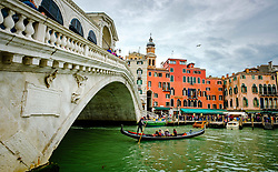 Gondola passing under the Rialto Bridge (Ponte di Rialto) on the Grand Canal in Venice, Italy<br /> <br /> (c) Andrew Wilson | Edinburgh Elite media