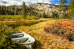 """Boat at Mud Lake 1"" - Photograph of a small fishing boat shot in the morning at Mud Lake in California's Plumas National Forest."
