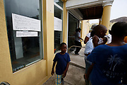 A child walks outside a food distribution point for people affected by Hurricane Irma in East End, Tortola, BVI.