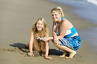 Mother and Daughter Together on Beach