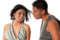 Multiracial young couple having fun and chatting.