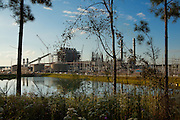 """Kemper County, MS – OCTOBER 4, 2013: <br /> The Kemper County Energy Facility sits just beyond a 75-acre reservoir, which holds the energy facility's cooling water. The facility, which received a $270 million grant from the Department of Energy, is the first of its kind to use lignite coal in a """"combined cycle"""" approach to gasification – a method by which the combustion of synthetic gas produces electricity. Mississippi Power began construction on the facility in June 2010, but numerous delays and high cost overruns have prevented the plant from becoming commercially operational. CREDIT: Bob Miller for The Wall Street Journal<br /> <br /> CLEANCOAL"""