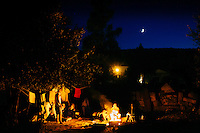 A family have a chat at night at Kara Tepe camp in Lesvos island, Greece on Aug 18th, 2015.