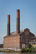 "Lots Road Power Station, Chelsea, London seen from the Thames may 2015. Built 1905, Decommissioned 2002.  Hutchison Whampoa Properties is developing the site as ""Chelsea Waterfront""."