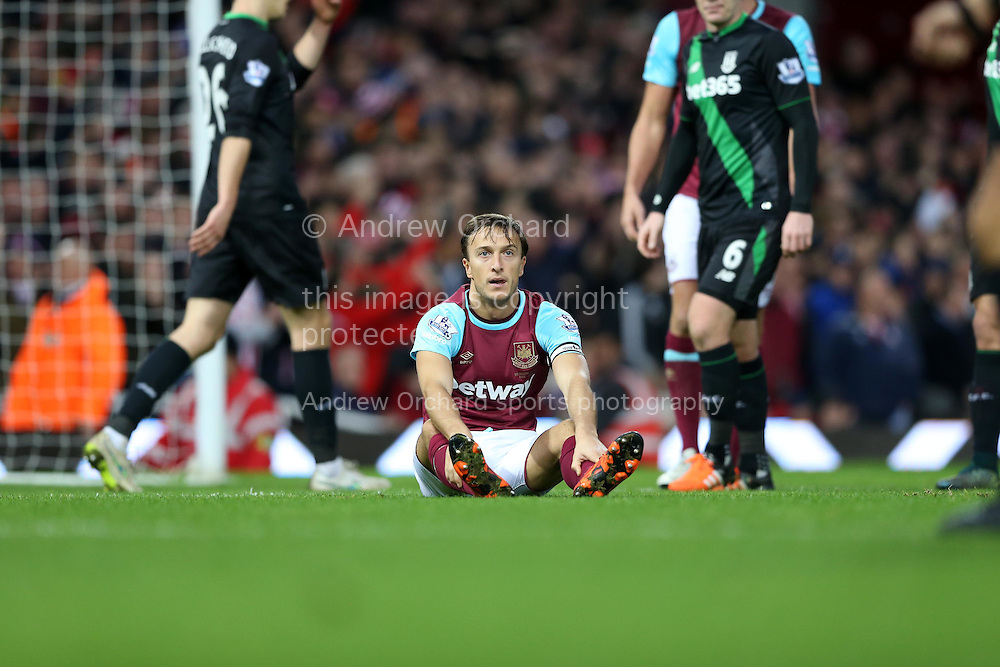 Mark Noble of West Ham United &copy; looks dejected as he is not awarded a penalty after being held down by Ryan Shawcross, the Stoke City captain in the penalty area. Barclays Premier league match, West Ham Utd v Stoke city at the Boleyn Ground, Upton Park  in London on Saturday 12th December 2015.<br /> pic by John Patrick Fletcher, Andrew Orchard sports photography.