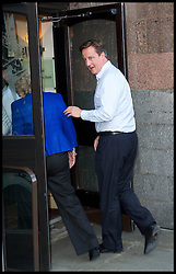 The Prime Minister David Cameron arrives at the Conservative Party Conference hotel for the start of the Conservative Party Autumn Conference in Manchester, United Kingdom. Saturday, 28th September 2013. Picture by Elliot Franks / i-Images