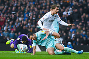 Queens Park Rangers defender Lee Wallace (3) tackles Leeds United forward Patrick Bamford (9) during the EFL Sky Bet Championship match between Leeds United and Queens Park Rangers at Elland Road, Leeds, England on 2 November 2019.