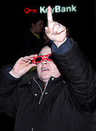A visitor tries on the CareSource 'magic glasses' during the Grande Illumination & Dayton Children's Parade Spectacular in Lights which begins the 39th Annual Dayton Holiday Festival in Courthouse Square in downtown Dayton, Friday, November 25, 2011.  The glasses are said to allow 'watching the tree lighting and parade to see the holiday lights in a whole new way.'
