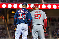 Mike Trout #27 of the Los Angeles Angels talks with Justin Morneau #33 of the Minnesota Twins on April 16, 2013 at Target Field in Minneapolis, Minnesota.  The Twins defeated the Angels 8 to 6.  Photo: Ben Krause