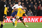 Wolverhampton Wanderers defender Jonny Castro (19) battles with Erik Lamela midfielder of Tottenham Hotspur (11) during the Premier League match between Wolverhampton Wanderers and Tottenham Hotspur at Molineux, Wolverhampton, England on 3 November 2018.