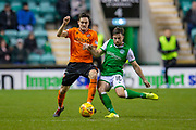 Lewis Stevenson (#16) of Hibernian FC tackles Liam Smith (#2) of Dundee United FC during the William Hill Scottish Cup fourth round match between Hibernian FC and Dundee United FC at Easter Road Stadium, Edinburgh, Scotland on 28 January 2020.