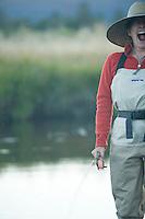 Sarah Meredith fly fishing small meadow stream near Lake Tahoe, CA.