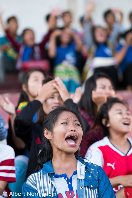 University football game, students in audience, Hpa-an, Myanmar