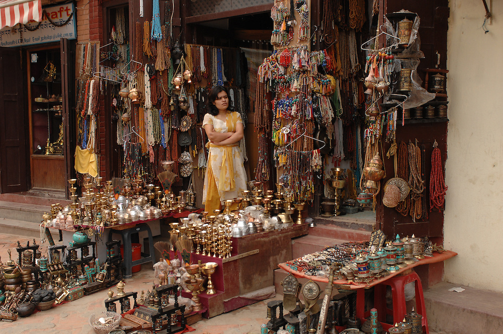 A woman minding one of the many gift shops surrounding Boudhanath stupa, in Nepal.