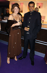 AMBER NUTTALL and SATYAJIT CHATTERJEE at The British Red Cross London Ball - H2O The Element of Life, held at The Room by The River, 99 Upper Ground, London SE1 on 17th November 2005.<br />