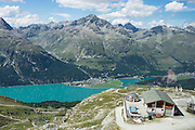 "Descend Corvatsch lift to Surlej, with views of Lake Silvaplana, in Upper Engadine, in Graubünden (Grisons) canton, Switzerland, the Alps, Europe. The Swiss valley of Engadine translates as the ""garden of the En (or Inn) River"" (Engadin in German, Engiadina in Romansh, Engadina in Italian)."