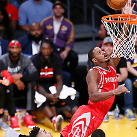 26 October 2016: Houston Rockets forward Trevor Ariza (1) goes for the layup past Los Angeles Lakers guard D'Angelo Russell (1) and Los Angeles Lakers forward Luol Deng (9) during the Los Angeles Lakers 120-114 victory over the Houston Rockets, at the Staples Center, Los Angeles, California, USA.