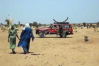 Niger, Agadez, Tidene, 2007.  Rissa Ixa's 4 x 4 carries curved steel well sections to be delivered to a new Tuareg well site.
