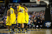 The University of Michigan Wolverines huddle up during overtime against the University of Kansas Jayhawks during the NCAA South Regionals at Cowboys Stadium in Arlington on Friday, March 29, 2013. (Cooper Neill/The Dallas Morning News)
