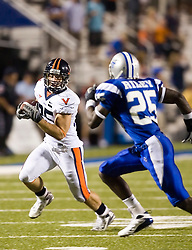 "Virginia tight end John M. Phillips (85) rushes around Middle Tennessee State cornerback Ted Riley (25)...The Virginia Cavaliers football team defeated Middle Tennessee State Blue Raiders 23-21 at Johnny ""Red"" Floyd Stadium  in Murfreesboro, TN on October 6, 2007."