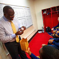 BLOOMINGTON, IN -- February 3, 2013 -- University of Michigan assistant coach Bacari Alexander pulls out an egg with the IU logo on it during a pre-game speech as they prepare to play the Indiana University Hoosiers at Assembly Hall in Bloomington, Indiana.  (PHOTO / CHIP LITHERLAND)