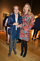SABRINA PERCY and PHINEAS PAGE at a party to celebrate the publication of Capability Brown & Belvoir - Discovering a lost Landscape by The Duchess of Rutland, held at Christie's, 8 King Street, St.James, London on 7th October 2015.