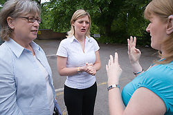 Woman talking through interpreter to deaf woman at The Nottinghamshire Deaf Society,