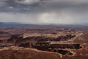 Rain moves across the desert, as seen from Grand View Overlook, in the Island in the Sky district, in Canyonlands National Park, near Moab, Utah.
