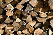 Wood pile of timber logs seasoning makes an interesting shape and pattern, The Cotswolds, Oxfordshire