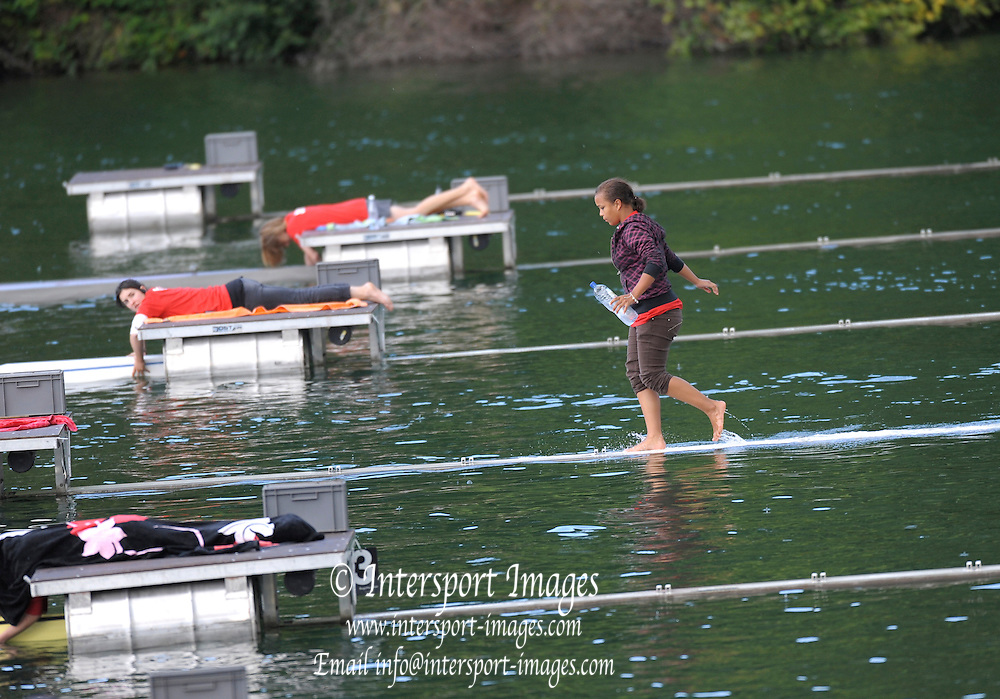 Lucerne, SWITZERLAND,  Boat holder adjusting the start dock third round of the  2009 FISA World Cup,  on the Rottsee regatta Course, Friday  10/07/2009  [Mandatory Credit Peter Spurrier/ Intersport Images].
