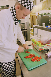 Chef preparing salad in hospital kitchen,