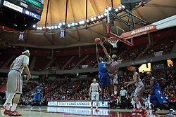 26 February 2014:  Demetrius Moore leans away from Reggie Lynch while lifting the ball to the basket during an NCAA Missouri Valley Conference (MVC) mens basketball game between the Indiana State Sycamores and the Illinois State Redbirds  in Redbird Arena, Normal IL.