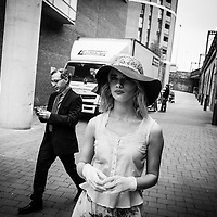 Street style shot of young female model in street