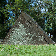 "August 20, 2012 - Purchase, NY : Jackie Ferrara's 'A 120 Stacked Pyramid, 1973' (Wood, 104.5"" x 164"" x 47"", collection Neuberger Museum of Art) is located behind the Neuberger Museum of Art at SUNY Purchase. CREDIT: Karsten Moran for The New York Times"