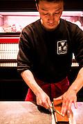 Chef sharpening knife at Tsurugyu restuarant.