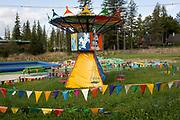 A landscape of a Polish version of Disneyland that features a childrens' merry-go-round carousel, on 18th September 2019, near the Wielka Krokiew ski jump, Zakopane, Malopolska, Poland.