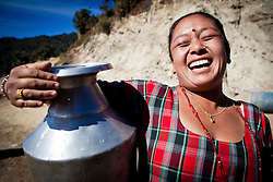 Portrait of a joyful woman carrying a jar, Nepalgunj, Nepal, Asia