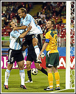Argentina's midfielder Luciano Figueroa (C) celebrates with his teammate Esteban Cambiasso (L) after scoring a goal against Australia during their Confederations Cup football match in Nuremberg, Germany, on June 18, 2005. (Alejandro Pagni/PHOTOXPHOTO)