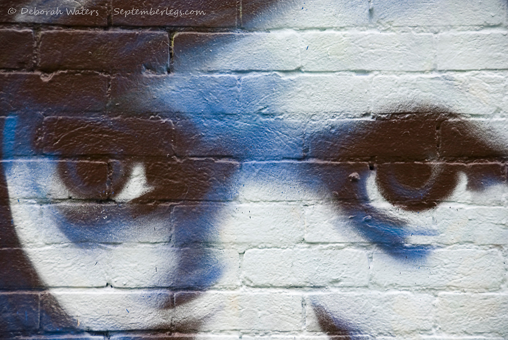 Blue Black and White Eyes of Boy Child Painted on Brick Wall, Oxford England