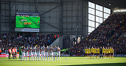 WEST BROMWICH, ENGLAND - Saturday, March 19, 2011: West Bromwich Albion and Arsenal players stand for a minute's silence to remember those who lost their lives in the earthquake and tsunami in Japan before the Premiership match at the Hawthorns. (Photo by David Rawcliffe/Propaganda)