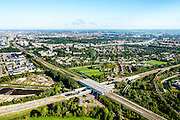 Nederland, Noord-Holland, Gemeente Ouder-Amstel , 27-09-2015; Duivendrecht, Station Duivendrecht, treinstation en metrostation. Het station ligt aan de Ringspoorbaan en de Utrechtboog. Naast het station de Sint-Urbanuskerk.<br /> Duivendrecht Railway station. <br /> luchtfoto (toeslag op standard tarieven);<br /> aerial photo (additional fee required);<br /> copyright foto/photo Siebe Swart
