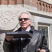 NLD/Amsterdam/20130413 - Regisseur en cameraman Jan de Bont en partner Tracy,
