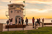 Locals Enjoying the Sunset at Main Beach Lifeguard Tower in Laguna Beach