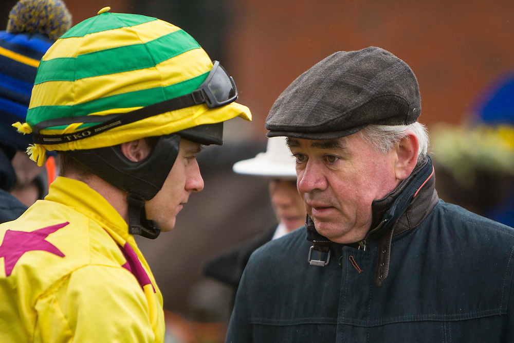 "Fairyhouse Racing, 1st January 2016<br /> Edward Cawley pictured talking to ""Arise and go Now"" jockey - Chris Timmons before the start of the ""Clubs fundraiser Handicap Hurdle"" at Fairyhouse<br /> Photo: David Mullen /www.cyberimages.net / 2016"