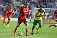 Federico Macheda of Cardiff city &copy; makes a break. Skybet football league championship match, Cardiff city v Norwich city at the Cardiff city Stadium in Cardiff, South Wales on Saturday 13th Sept 2014<br /> pic by Andrew Orchard, Andrew Orchard sports photography.