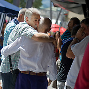 Two local men kiss each other in a street of the Northern Spanish Basque city of Bilbao, on August 25, 2011. Photo Rafa Rivas