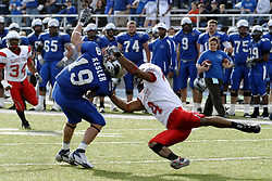25 November 2006: Pierre Jackson gets Adam Kesler by the facemask during a tackle. The Redbirds romped the Panthers by a score of 24-13. This game was a 1st round NCAA Division 1 Playoff held at O'Brien Stadium on the campus of Eastern Illinois University in Charleston Illinois.<br />