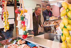 © Licensed to London News Pictures. 18/04/2016. Sheffield UK. Picture shows Nigel Farage buying sausages from a butchers shop in Sheffield. Nigel Farage has been in sheffield today to support Steve Winstone's campaign in the Sheffield Brightside & Hillsborough by election. Photo credit: Andrew McCaren/LNP