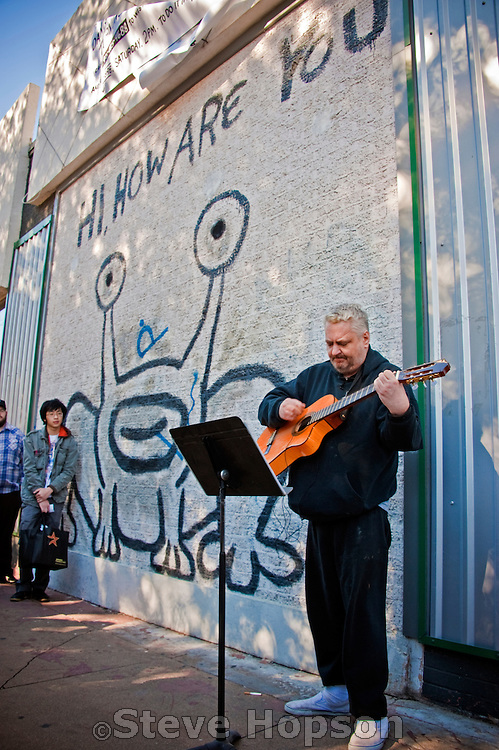 Daniel Johnston performs in front of the Jeremiah the Innocent mural on his 50th Birthday, Austin Texas, January 2, 2011. Daniel Dale Johnston (born January 22, 1961) is an American singer, songwriter, musician, and artist. Johnston was the subject of the 2006 documentary The Devil and Daniel Johnston and painted the Jeremiah the Innocent (Hi How Are You) mural on the Drag in Austin.
